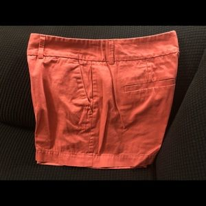 Rust colored shorts.